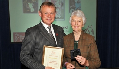 Jenny being presented with an award by Martin Clunes for their dedication to Equine Welfare by the British Horse Society – November 2011