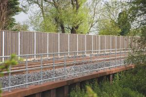 6 Noisevac Noise Absorbent Barrier protecting nearby homes from railway noise