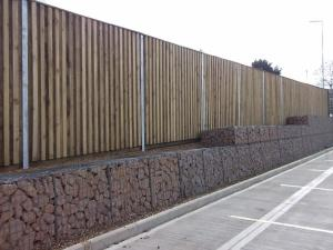 3 Noisewall + Double sided Reflective Barrier in an industrial setting