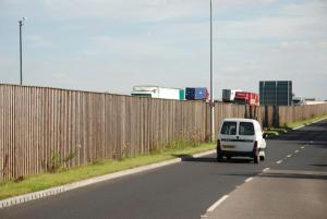4 Noisewall + Double sided Reflective Barrier reducing the impact of road noise on nearby homes